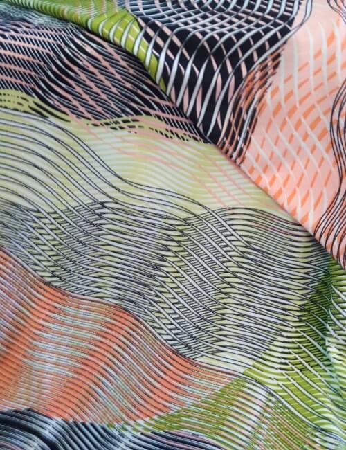 Maglina fantasia geometrico con sfumature tiffany