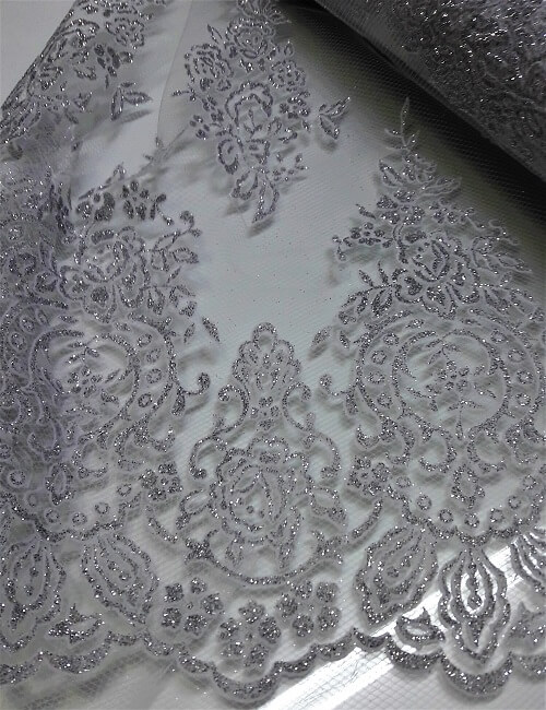 Tulle glitter argento fondo bianco