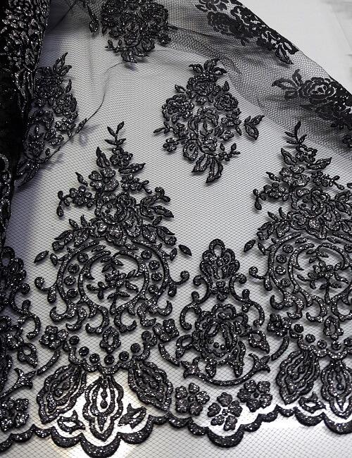 Tulle glitter argento fondo nero